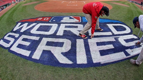 World Series Dodgers Red Sox Baseball, Boston, USA - 21 Oct 2018 Grounds crew members paint the World Series logo behind home plate at Fenway Park, in Boston as they prepare for Game 1 of the baseball World Series between the Boston Red Sox and the Los Angeles Dodgers scheduled for Tuesday