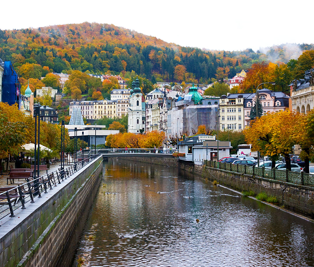 In Karlovy Vary, the embankment of the Tepla river in autumn