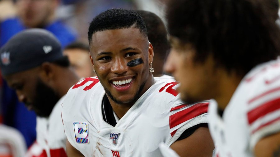 Giants Lions Football, Detroit, USA - 27 Oct 2019 New York Giants running back Saquon Barkley smiles on the bench against the Detroit Lions during an NFL football game in Detroit 27 Oct 2019