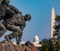 The U.S. Marine Corps War Memorial with the Capital Building and the Washington Monument in the background