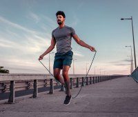 Man jumping rope outdoors