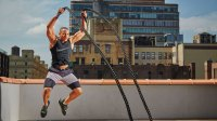 Man working out with battle ropes