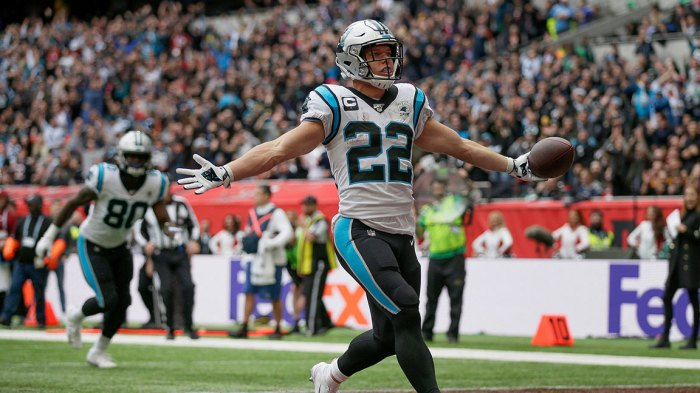 Panthers Buccaneers Football, London, USA - 13 Oct 2019 Carolina Panthers running back Christian McCaffrey (22) reacts after scoring a touchdown against the Tampa Bay Buccaneers during the second quarter of an NFL football game, at Tottenham Hotspur Stadium in London 13 Oct 2019