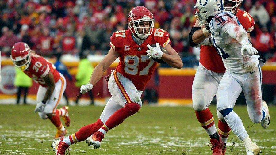 Colts Chiefs Football, Kansas City, USA - 12 Jan 2019 Kansas City Chiefs tight end Travis Kelce (87) runs with the ball as offensive tackle Eric Fisher (72) blocks Indianapolis Colts cornerback Quincy Wilson (31) during the first half of an NFL divisional football playoff game in Kansas City, Mo 12 Jan 2019