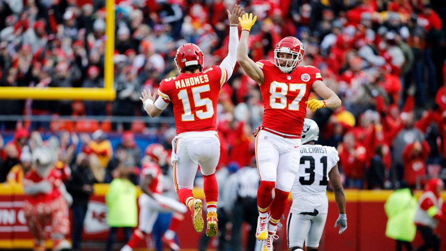 Raiders Chiefs Football, Kansas City, USA - 30 Dec 2018 Kansas City Chiefs quarterback Patrick Mahomes (15) celebrates with tight end Travis Kelce (87) after throwing a 67-yard touchdown pass to Tyreek Hill during the first quarter of an NFL football game against the Oakland Raiders in Kansas City, Mo., . Mahomes threw for 281 yards in the game, joining Peyton Manning as the only two QB's to reach over 5,000 passing yards and 50 touchdowns from the air in the same season 30 Dec 2018