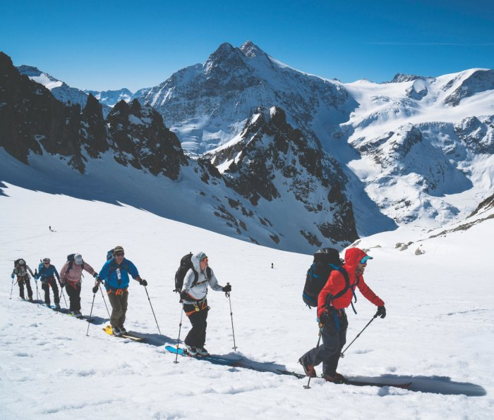Skinning up a remote col to ski down