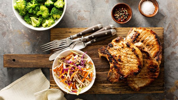 Grilled pork chops with cole slaw salad and steamed broccoli