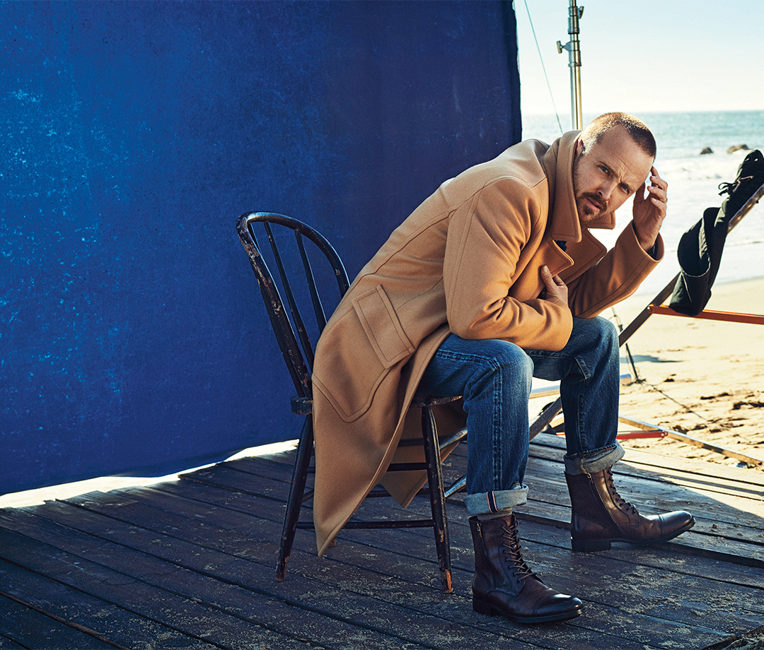 Paul wears coat by Mr P; jeans by The Workers Club Denim; boots by Kenneth Cole