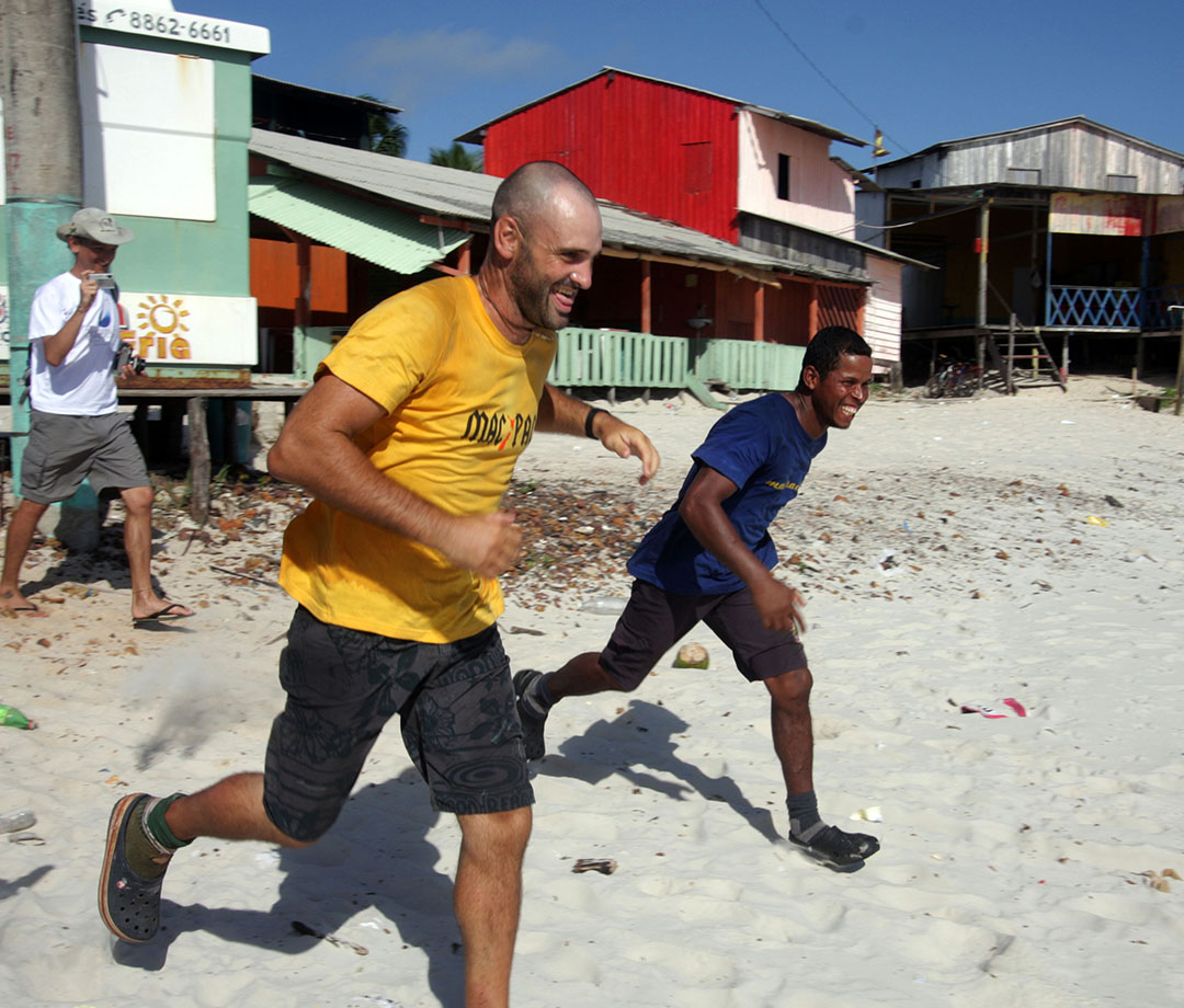 "Ed Stafford and Gadiel ""Cho"" Sanchez Rivera run on Crispim beach in Brazil"