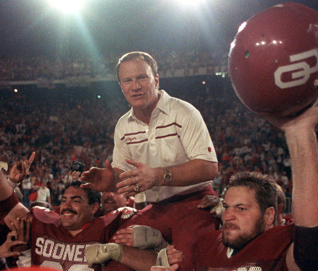 Barry Switzer with his Oklahoma Sooners after their victory over Penn State in 1986