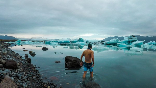 polar plunging man in a glacier lagoon