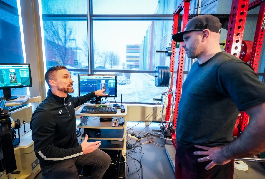 Matt Jordan, Director of Sport Science at the Canadian Sport Institute Calgary, is reviewing data collected on Olympian skier Manuel Osborne-Paradis during his rehabilitation of a lower leg injury. Photo: Courtesy of Dave Holland, Canadian Sport Institute Calgary.