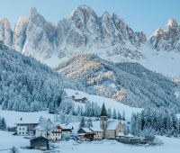 Val di Funes covered in snow near the Dolomites mountains, South Tyrol, Italy