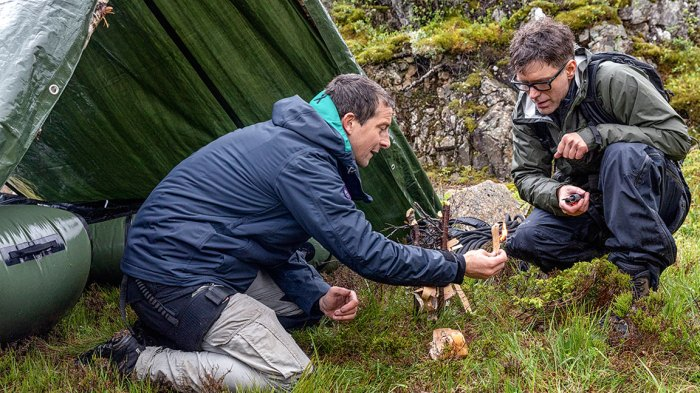 Månafossen, Norway - (L to R) Bear Grylls and Bobby Bones start a box fire in National Geographic's RUNNING WILD WITH BEAR GRYLLS. (Photo credit: National Geographic/Ben Simms)