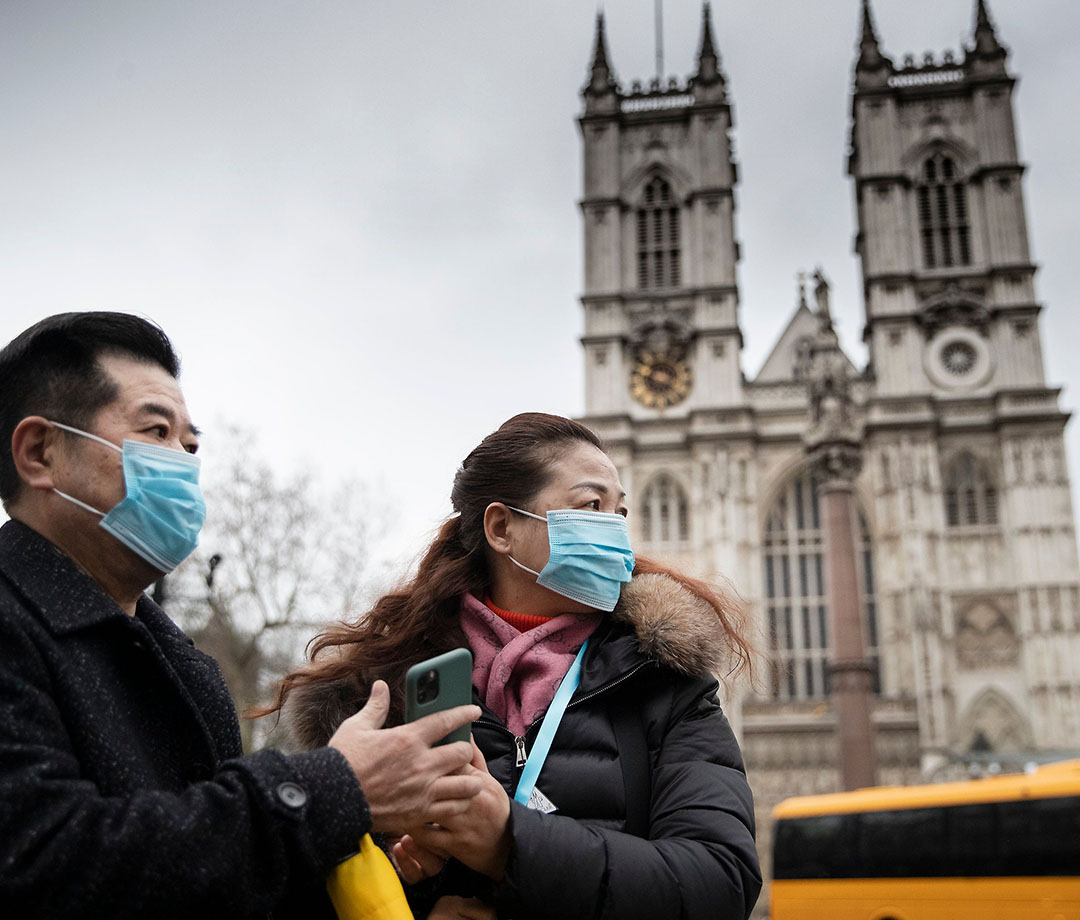 Londoners visiting Westminster Abbey wearing face masks