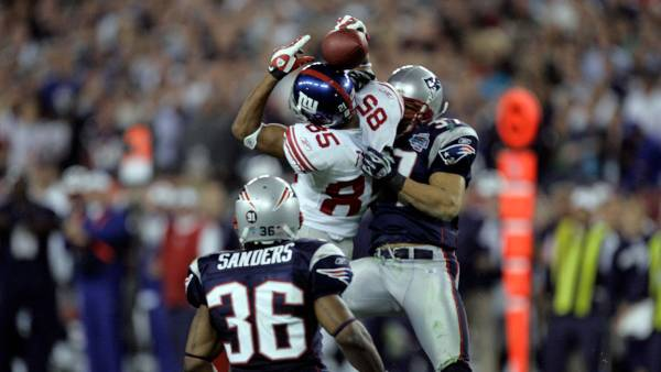 Super Bowl Football, Glendale, USA David Tyree, Rodney Harrison New York Giants David Tyree #85 catches a pass against the New England Patriots Rodney Harrison #37 during the Super Bowl XLII football game at University of Phoenix Stadium on in Glendale, Ariz. Giants QB Eli Manning completed a miracle 32-yard pass to Tyree on the play to set up their winning td 3 Feb 2008