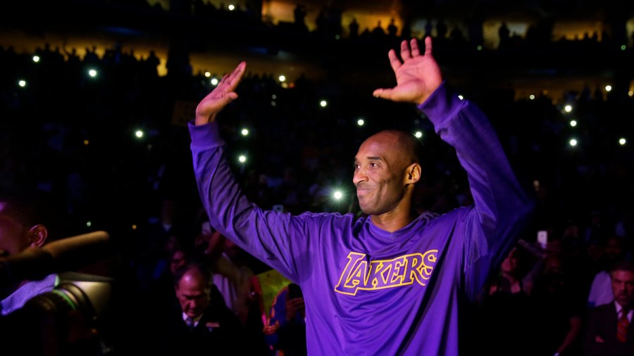 Lakers 76ers Basketball, Philadelphia, USA Kobe Bryant Los Angeles Lakers' Kobe Bryant acknowledges the audience ahead of a basketball game against the Philadelphia 76ers, in Philadelphia 1 Dec 2015
