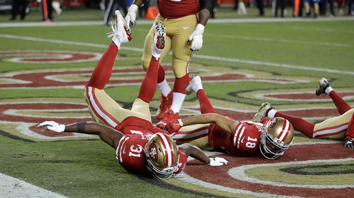 Packers 49ers Football, Santa Clara, USA - 24 Nov 2019 San Francisco 49ers running back Raheem Mostert (31) celebrates after scoring a touchdown with wide receiver Dante Pettis (18) during the second half of an NFL football game against the Green Bay Packers in Santa Clara, Calif 24 Nov 2019