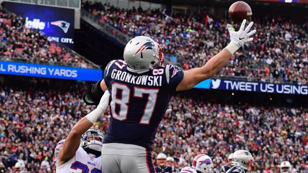 Buffalo Bills at New England Patriots, Foxboro, USA - 24 Dec 2017 New England Patriots tight end Rob Gronkowski (R) makes a touchdown catch as Buffalo Bills strong safety Micah Hyde (L) defends during the first half at Gillette Stadium in Foxboro, Massachusetts, USA 24 December 2017. 24 Dec 2017