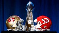 Lombardi Trophy and the 49ers and Chiefs, Miami, USA - 29 Jan 2020 The NFL Super Bowl Vince Lombardi trophy on display with the NFC Champions San Francisco 49ers helmet and the AFC Champions Kansas City helmet before NFL Commissioner Roger Goodell's press conference in Miami, Florida, USA, 29 January 2020. The San Francisco 49ers and the Kansas City Chiefs will play in Super Bowl LIV at Hard Rock Stadium in Miami Gardens, Florida, USA on 02 February 2020. 29 Jan 2020