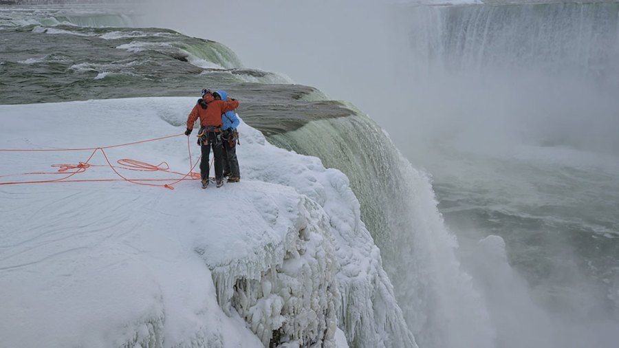 Will Gadd and Sarah Hueniken hugs each other folllowing their first ascents, during Red Bull Frozen Falls at Niagara Falls, NY, USA on 27 January, 2015.