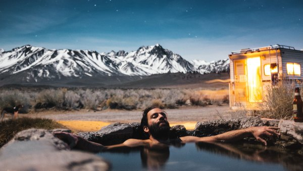 Man soaking in Mammoth Lakes hot spring