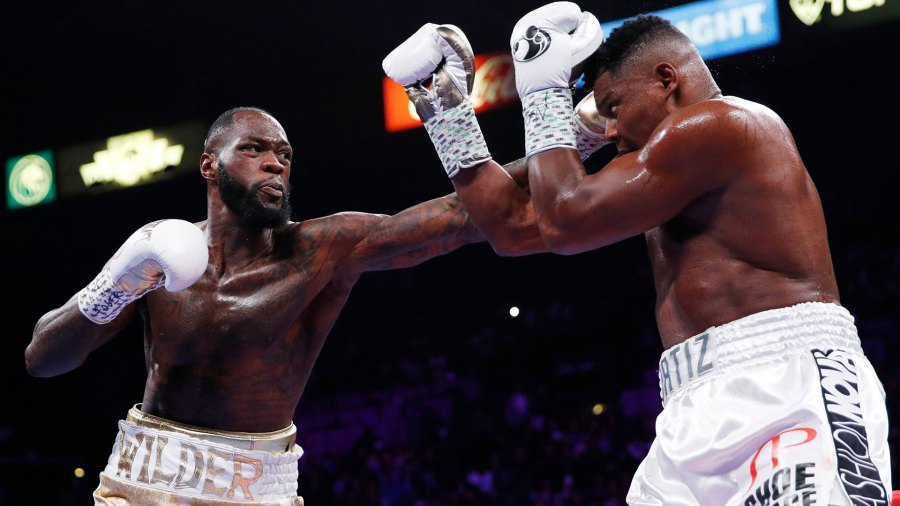 Wilder Ortiz Boxing, Las Vegas, USA - 23 Nov 2019 Deontay Wilder, left, throws a left at Luis Ortiz during the WBC heavyweight title boxing match, in Las Vegas 23 Nov 2019
