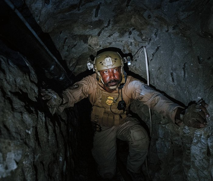 """Orlando Chavis explores a tunnel. """"I don't have fear,"""" he says, """"just awareness of the environment."""""""