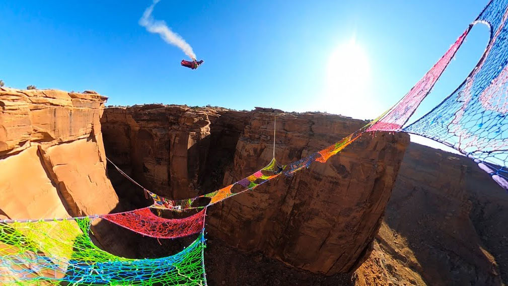 Watch: Wingsuit Flyer Screams Through Net Suspended Over Utah Canyon