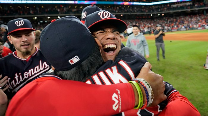 YE Ode To Sports, Houston, USA - 30 Oct 2019 Shows Washington Nationals left fielder Juan Soto, right, hugging catcher Kurt Suzuki after Game 7 of the baseball World Series against the Houston Astros in Houston. Washington, really? Can that be? First World Series since '33 30 Oct 2019 Image ID: 10508974a Featured in: YE Ode To Sports, Houston, USA - 30 Oct 2019 Photo Credit: David J Phillip/AP/Shutterstock