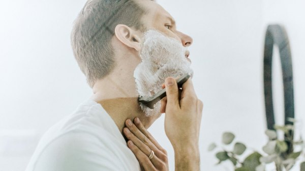 Man shaving at home