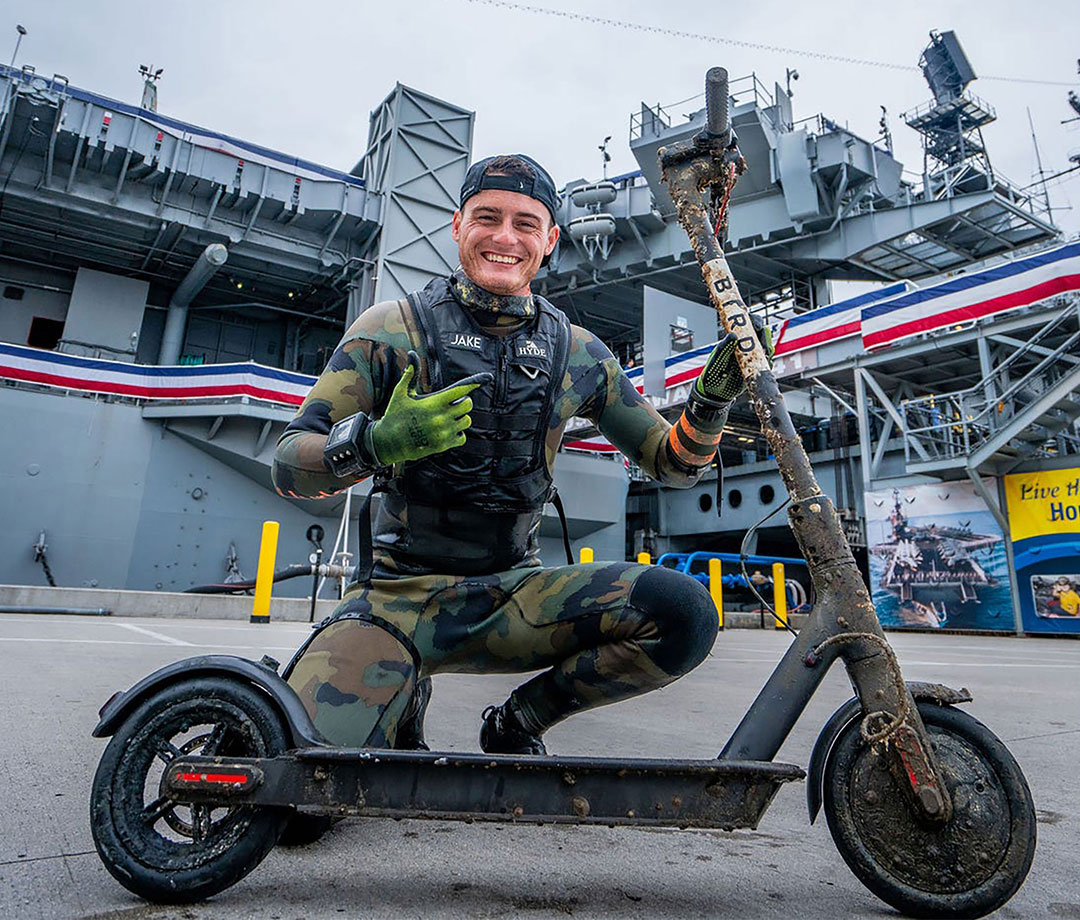 Koehler with a scooter he found while diving with the Navy.