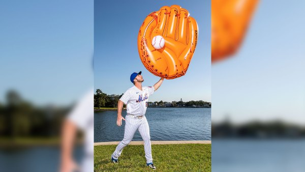 Pete Alonso of the Mets holding a giant inflatable mitt