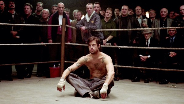 Brad Pitt as bare-knuckle boxer Mickey, sitting in a boxing ring, in 'Snatch'