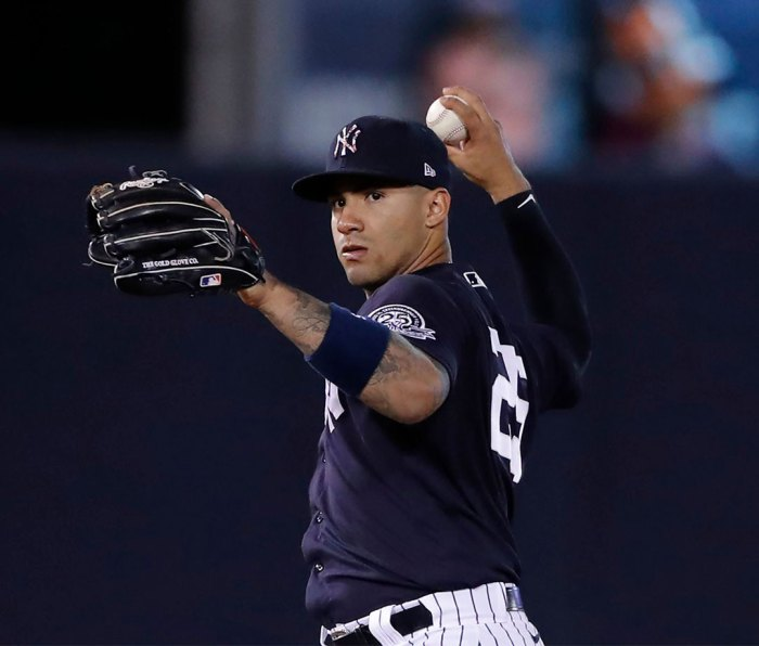 New York Yankees second baseman Gleyber Torres throws to first during a spring training baseball game, in Tampa, Fla