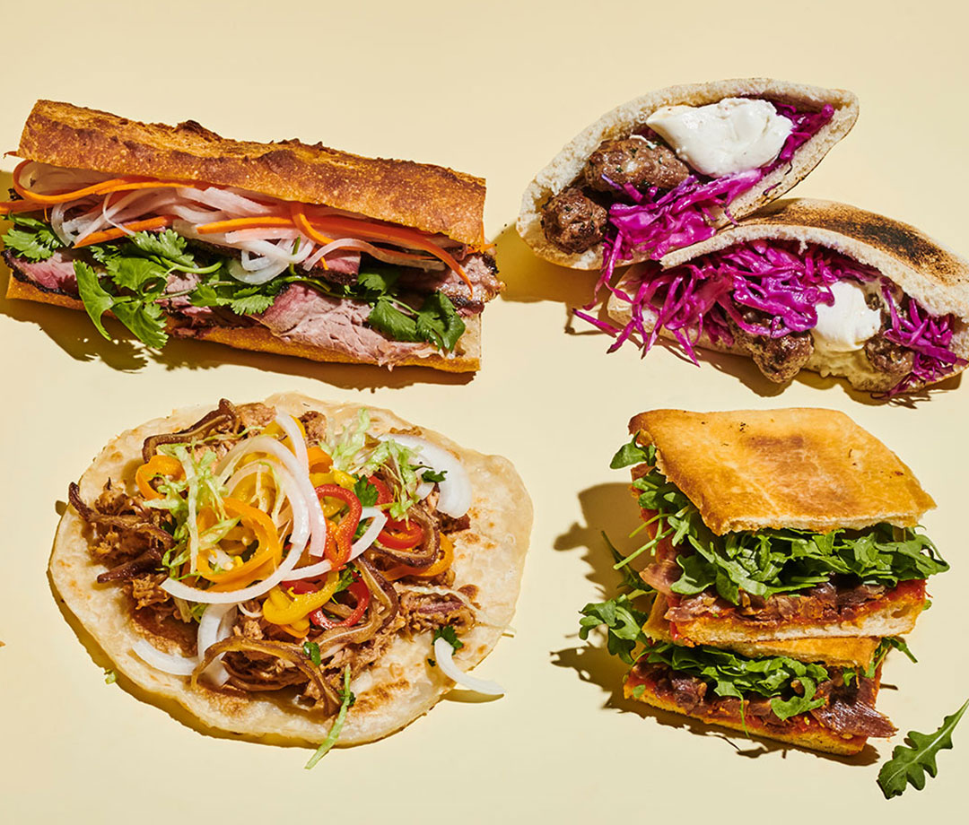 Clockwise from top left: Smoked Brisket Banh Mi, Ćevapi, Overnight Duck Confit Panini, and Pork & Peppers