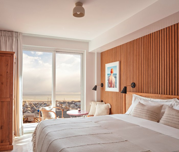 Bedroom with beach view at The Rockaway Hotel