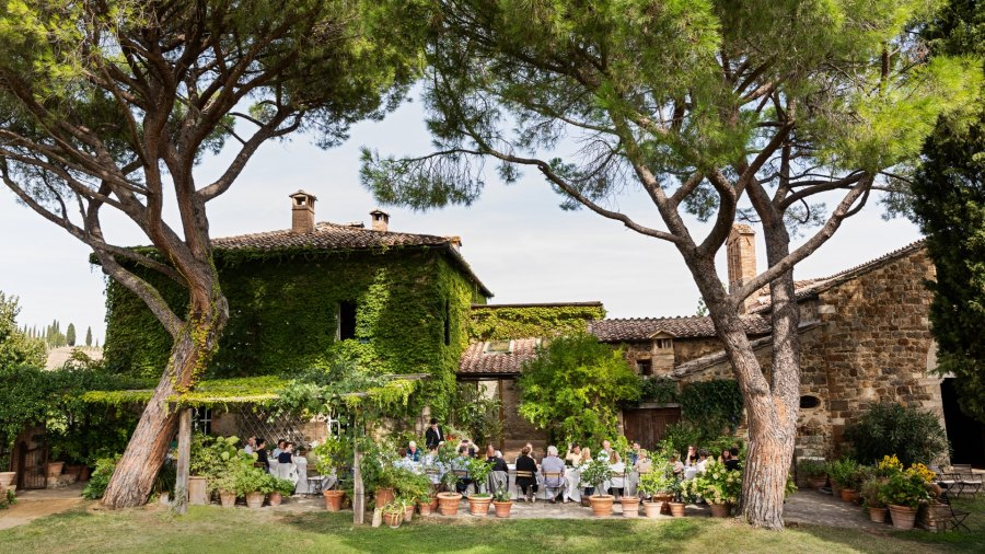 Guests sitting down to lunch at winery Castello di Argiano, owned by Giuseppe Maria Sesti—namesake of the Sesti winery—in Montalcino, Tuscany