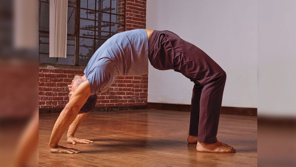 Man doing yoga wheel pose