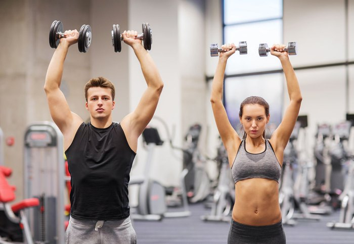 Dumbbell Push Press Man and Woman in Gym