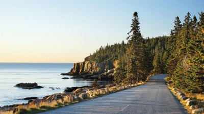 Driving Park Loop Road along the rocky shoreline of Maine's Acadia National Park.