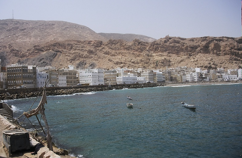 The town of Mukalla, capital of the Hawdramawt, spreads along the Indian Ocean.
