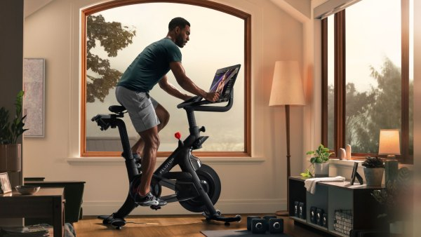 Man exercising at home on Peloton Bike+