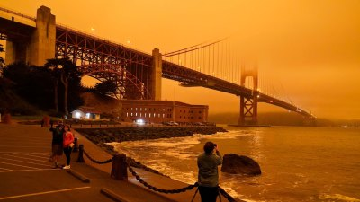 San Francisco was shrouded in orange skies for much of Wednesday due to smoke from multiple wildfires.