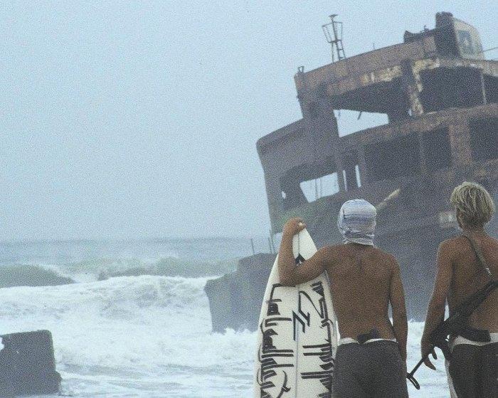 Finding waves breaking off rusty, jagged, menacing shipwrecked tanker post pirate invasion, near Nishtun.
