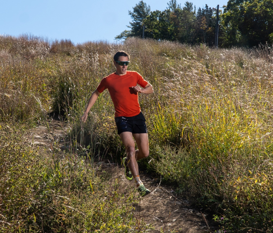 OCR athlete Ryan Kempson running down a hill at Blue Hills Ski resort in Canton, Massachusetts