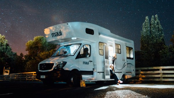 White Maui RV parked outside under a blanket of stars