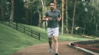 Man running outside with music and headphones