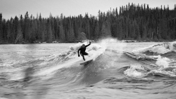 Calgary-based expeditioner Jacob Kelly Quinlan surfing at Molly Wave 2019