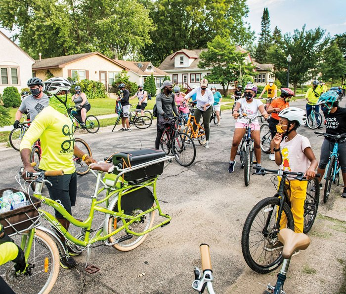 Taylor, masked up (in green) to lead the Sept. 5 community Slow Roll, launching four blocks west of the George Floyd Memorial Site.